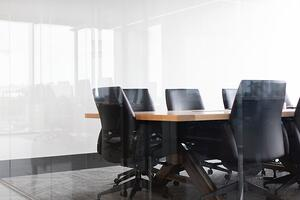 black chairs around meeting table