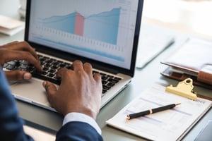 business man computer wealth management