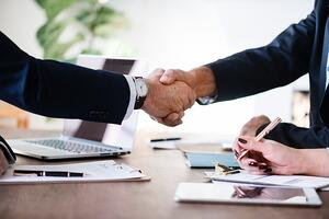 handshake relationship with financial advisor in business