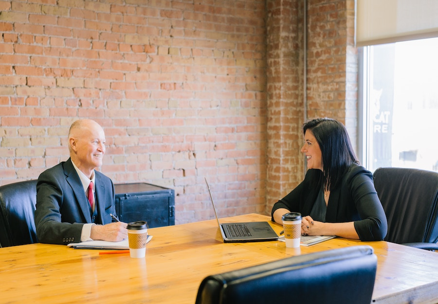 man and woman having a meeting in a conference room